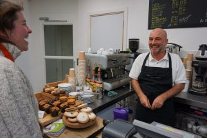 Cafe Supervisor John Scally jokes with a customer