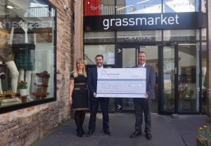 Scotch Whisky Experience handing over the donation